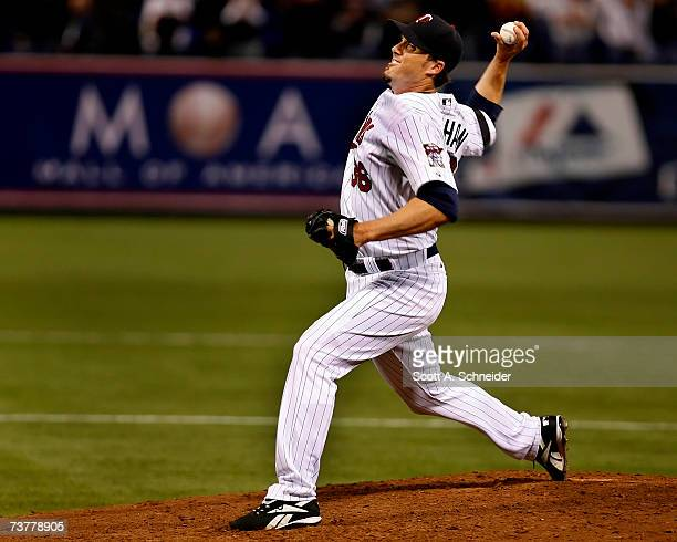 Joe Nathan of the Minnesota Twins pitches the ninth inning earning a save for the Minnesota Twins in their home opener against the Baltimore Orioles...
