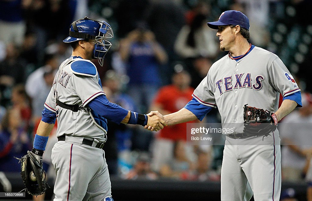 Joe Nathan #36 shakes hands with teammate A.J. Pierzynski #12 of the Texas Rangers after defeating the Houston Astros 4-0 at Minute Maid Park on April 3, 2013 in Houston, Texas.