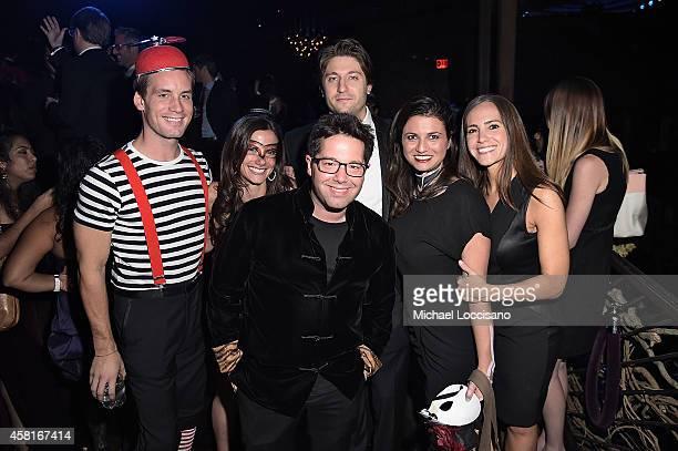 Joe Navarre, chair Danielle Abraham, Rowen Seibel, Marc Silber, Casey Rotter, Emily Jaffy appear at UNICEF Adventures in Wonderland Masquerade Ball...
