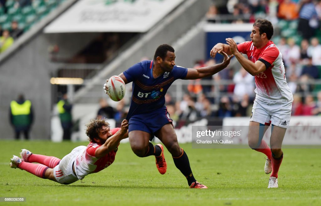 Joe Nayacavou (C) of Scotland is tackled during the HSBC London Sevens pool game between Scotland and France at Twickenham Stadium on May 20, 2017 in London, United Kingdom.