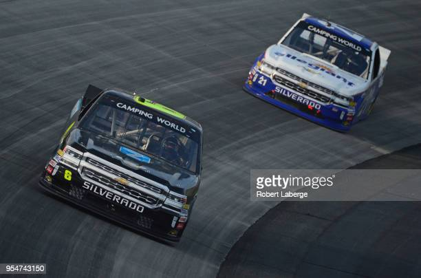 Joe Nemechek driver of the ACME Grocery Store Chevrolet leads a pack of trucks during the NASCAR Camping World Truck Series JEGS 200 at Dover...