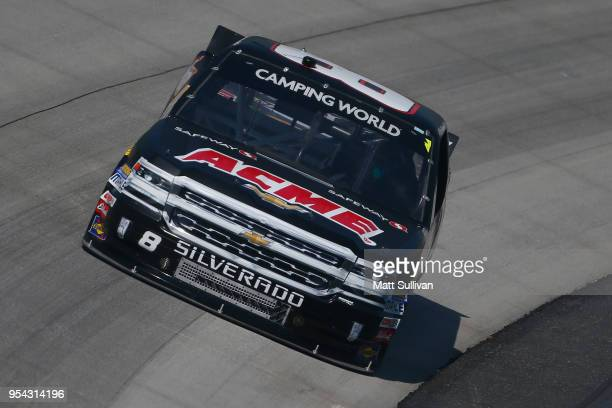 Joe Nemechek driver of the ACME Grocery Store Chevrolet practices for the NASCAR Camping World Truck Series JEGS 200 at Dover International Speedway...