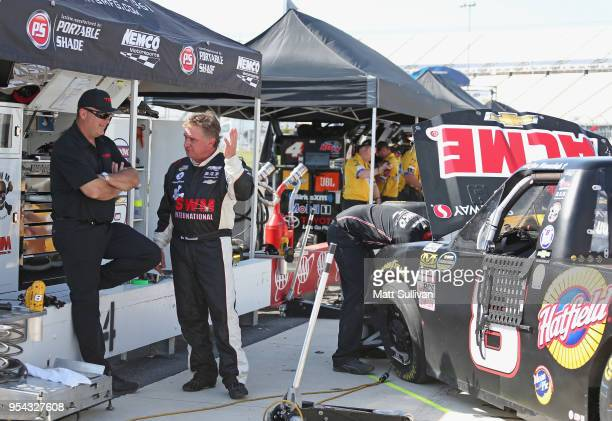 Joe Nemechek driver of the ACME Grocery Store Chevrolet stands by his truck during practice for the NASCAR Camping World Truck Series JEGS 200 at...