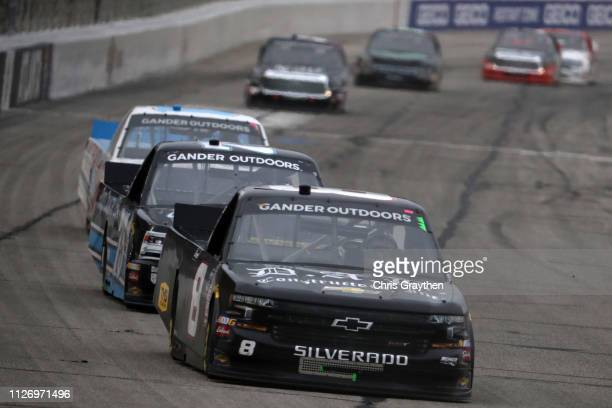 Joe Nemechek driver of the Chevrolet leads a pack of cars during the NASCAR Gander Outdoors Truck Series Ultimate Tailgating 200 at Atlanta Motor...