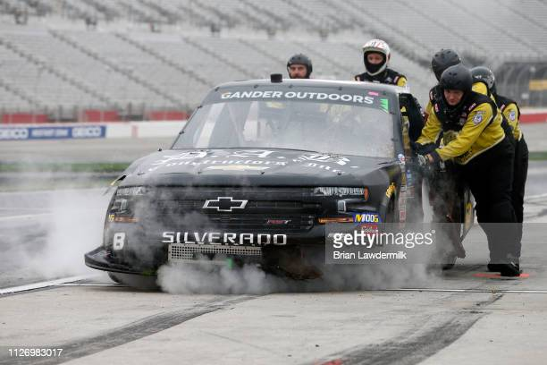 Joe Nemechek driver of the Chevrolet pits during the NASCAR Gander Outdoors Truck Series Ultimate Tailgating 200 at Atlanta Motor Speedway on...
