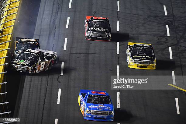 Joe Nemechek driver of the FoneFuel Chevrolet has an on track incident during the NASCAR Camping World Truck Series North Carolina Education Lottery...