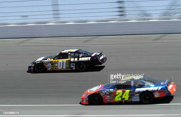 Joe Nemechek runs the outside lane with Jeff Gordon under him in the opening laps at the Auto Club 500 at the California Speedway in Fontana...