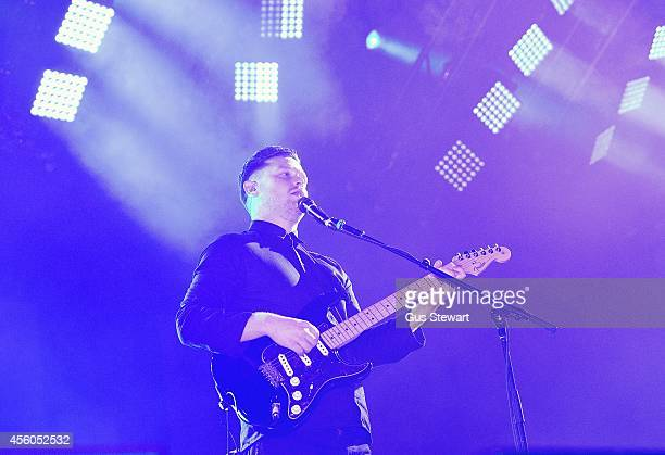 Joe Newman of altJ performs on stage at Alexandra Palace on September 24 2014 in London England
