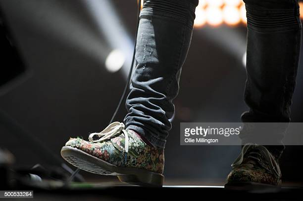 Joe Newman shoe detail of AltJ performs onstage at Nottingham Capital FM Arena on December 8 2015 in Nottingham England