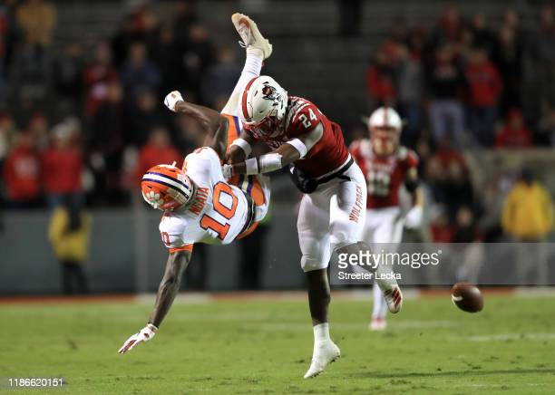 Joe Ngata of the Clemson Tigers goes up for a catch against Zonovan Knight of the North Carolina State Wolfpack during their game at CarterFinley...