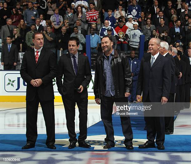 Joe Nieuwendyk Doug Gilmour Ed Belfour and Mark Howe prepare for the ceremonial faceoff prior to the game between the Ottawa Senators and the Toronto...