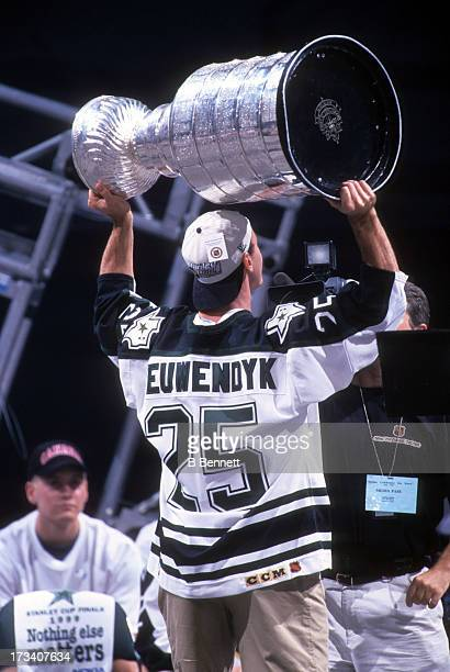 Joe Nieuwendyk of the Dallas Stars holds the Stanley Cup Trophy during the 1999 Stanley Cup Parade after defeating the Buffalo Sabres in Game 6 of...