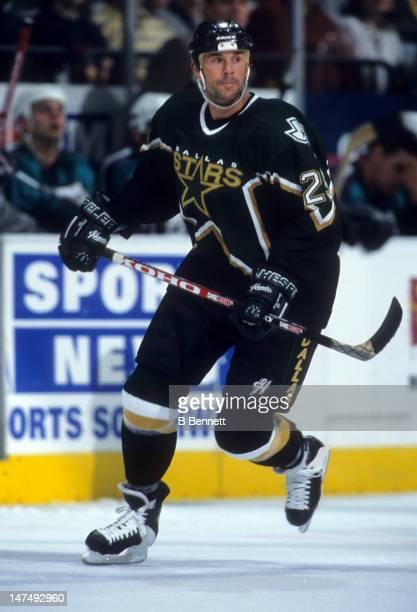Joe Nieuwendyk of the Dallas Stars skates on the ice during an NHL game circa 1999