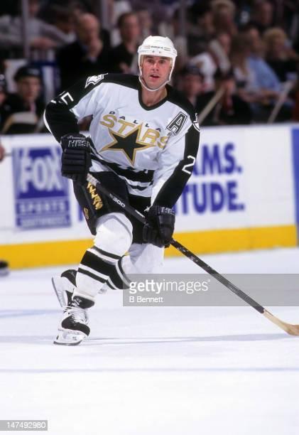 Joe Nieuwendyk of the Dallas Stars skates on the ice during an NHL game circa 1997