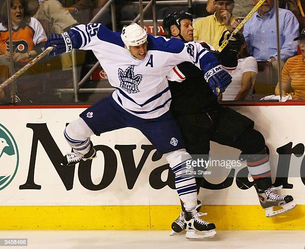 Joe Nieuwendyk of the Toronto Maple Leafs checks Marcus Ragnarsson of the Philadelphia Flyers during the second period of game one of the Eastern...