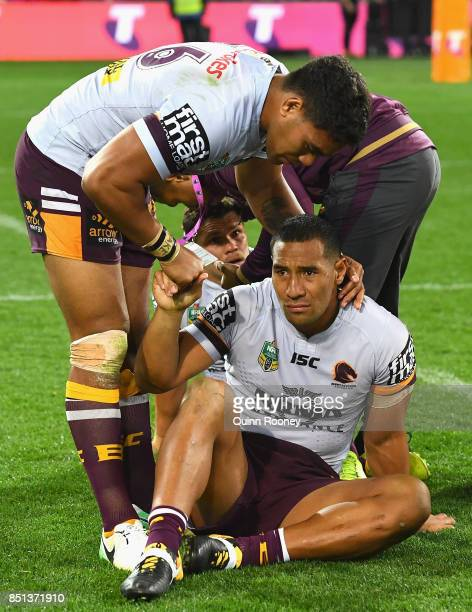 Joe Ofahengaue and Tautau Moga of the Broncos look dejected after losing the NRL Preliminary Final match between the Melbourne Storm and the Brisbane...