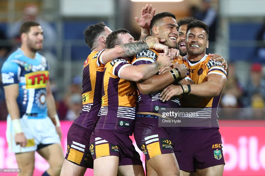Joe Ofahengaue of the Brocos celebrates with team mates after scoring a try during the round 17 NRL match between the Gold Coast Titans and the Brisbane Broncos at Cbus Super Stadium on July 8, 2018 in Gold Coast, Australia.