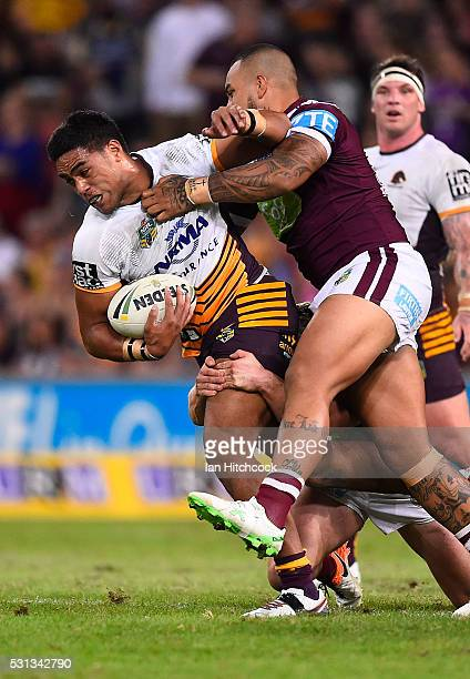Joe Ofahengaue of the Broncos is tackled by Addin FonuaBlake of the Sea Eagles during the round 10 NRL match between the Manly Sea Eagles and the...