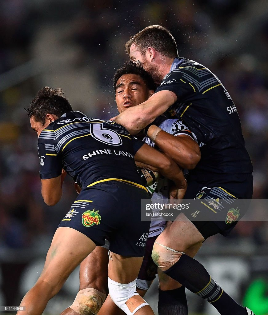 Joe Ofahengaue of the Broncos is tackled by Te Maire Martin and Gavin Cooper of the Cowboys during the round 26 NRL match between the North Queensland Cowboys and the Brisbane Broncos at 1300SMILES Stadium on August 31, 2017 in Townsville, Australia.