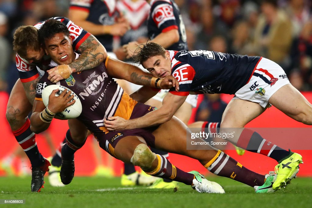 Joe Ofahengaue of the Broncos is tackled during the NRL Qualifying Final match between the Sydney Roosters and the Brisbane Broncos at Allianz Stadium on September 8, 2017 in Sydney, Australia.