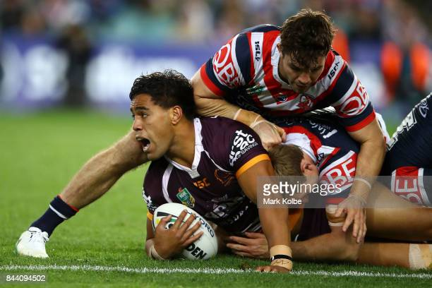 Joe Ofahengaue of the Broncos is tackled during the NRL Qualifying Final match between the Sydney Roosters and the Brisbane Broncos at Allianz...