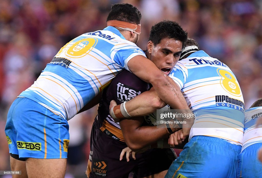 Joe Ofahengaue of the Broncos is tackled during the round four NRL match between the Brisbane Broncos and the Gold Coast Titans at Suncorp Stadium on April 1, 2018 in Brisbane, Australia.