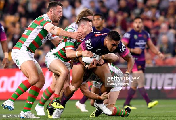 Joe Ofahengaue of the Broncos takes on the defence during the round 23 NRL match between the Brisbane Broncos and the South Sydney Rabbitohs at...