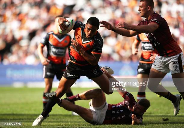Joe Ofahengaue of the Tigers is tackled during the round seven NRL match between the Wests Tigers and the Manly Sea Eagles at Bankwest Stadium, on...
