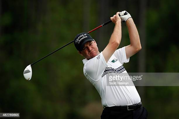 Joe Ogilvie of the United States hits a tee shot on the eighth hole during round one of the Shell Houston Open at the Golf Club of Houston on April 3...