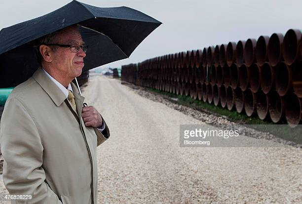 Joe Oliver Canada's natural resources minister looks on while holding an umbrella during a media event at the TransCanada Corp Houston Lateral...