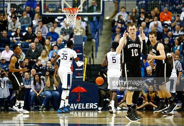 Joe O'Shea of the Byrant Bulldogs celebrates his three point shot in the first half against the Connecticut Huskies during the game at Harry A Gampel...