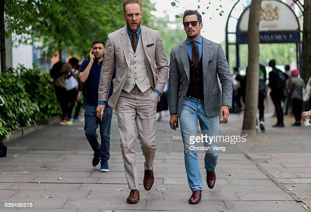 Joe Ottaway wearing a beige suit and model David Gandy wearing denim jeans and grey jacket outside Tiger of Sweden during The London Collections Men...