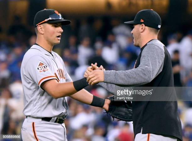 Joe Panik of the San Francisco Giants celebrates a 10 win over the Los Angeles Dodgers with Ty Blach during the 2018 Major League Baseball opening...