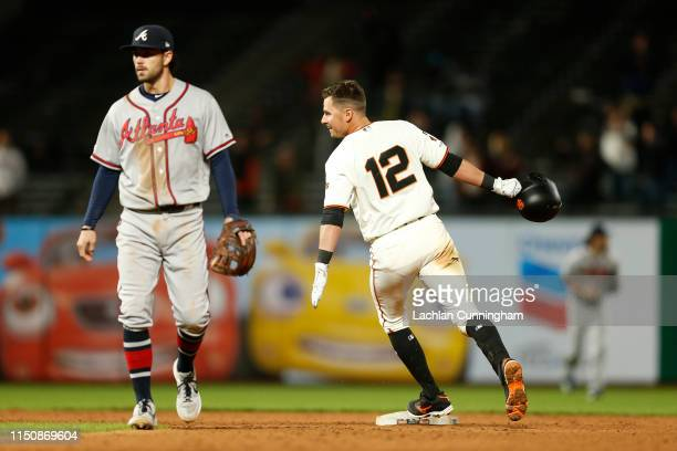 Joe Panik of the San Francisco Giants celebrates after hitting a tworun walkoff single in the bottom of the ninth inning against the Atlanta Braves...