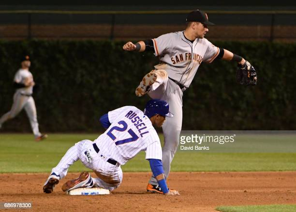 Joe Panik of the San Francisco Giants forces out Addison Russell of the Chicago Cubs at second base during the fifth inning on May 20 2017 at Wrigley...