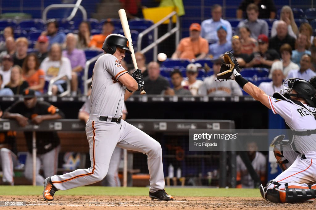 Joe Panik #12 of the San Francisco Giants gets out of the way of an inside pitch during the seventh inning against the Miami Marlins at Marlins Park on June 13, 2018 in Miami, Florida.