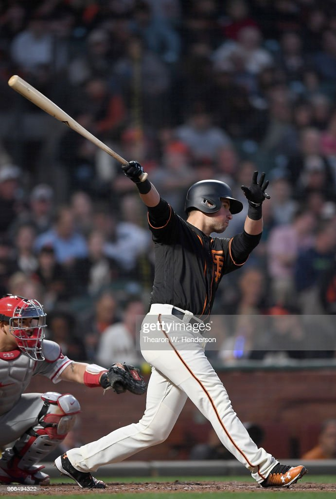 Joe Panik #12 of the San Francisco Giants hits a double against the Philadelphia Phillies in the bottom of the six inning at AT&T Park on June 2, 2018 in San Francisco, California.