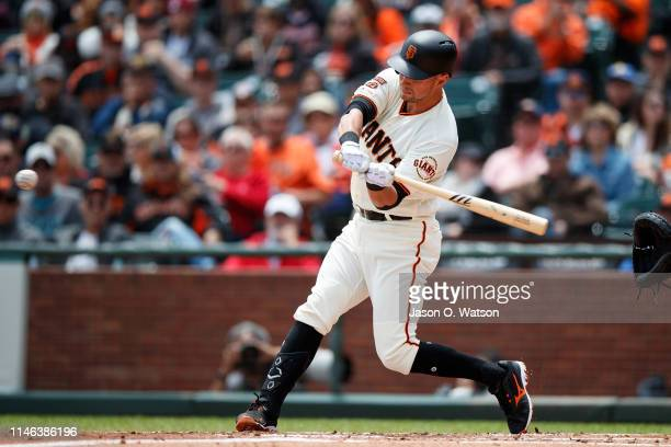 Joe Panik of the San Francisco Giants hits a double against the Arizona Diamondbacks during the first inning at Oracle Park on May 26, 2019 in San...