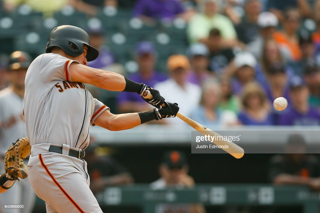 Joe Panik #12 of the San Francisco Giants hits a single during the eighth inning against the Colorado Rockies at Coors Field on September 4, 2017 in Denver, Colorado. The Rockies defeated the Giants 4-3.