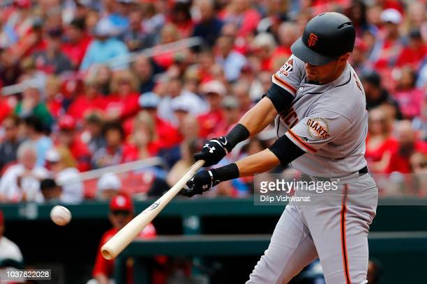 Joe Panik of the San Francisco Giants hits an RBI single against the St Louis Cardinals in the third inning at Busch Stadium on September 22 2018 in...