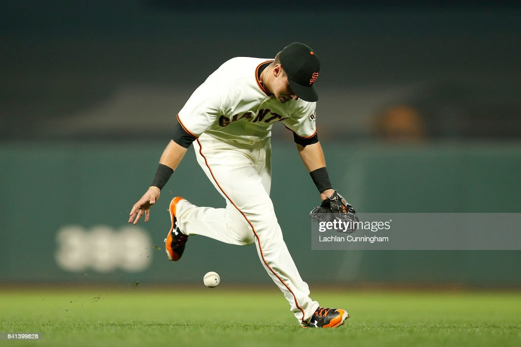 Joe Panik #12 of the San Francisco Giants misfields a ball hit by Greg Garcia #35 of the St Louis Cardinals in the seventh inning at AT&T Park on August 31, 2017 in San Francisco, California.