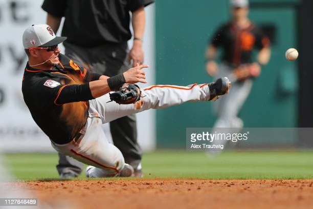 Joe Panik of the San Francisco Giants throws to first base during a Spring Training game against the Cincinnati Reds on Tuesday February 26 2019 at...