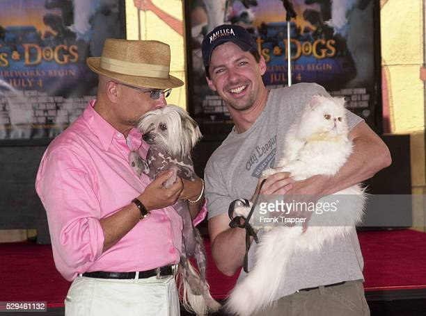 Joe Pantoliano and Sean Hayes from the new comedy Cats Dogs A finger and pawprint ceremony took place where hands and paws autographed concrete...
