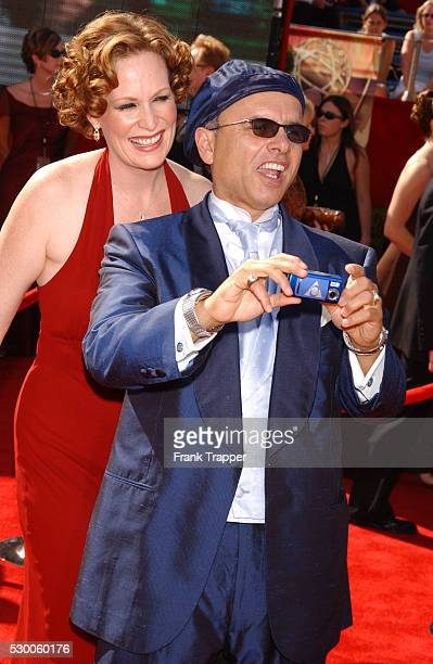 Joe Pantoliano takes a picture of himself and his wife Nancy Sheppard as they arrive at the 55th Annual Emmy Awards at the Shrine Auditorium