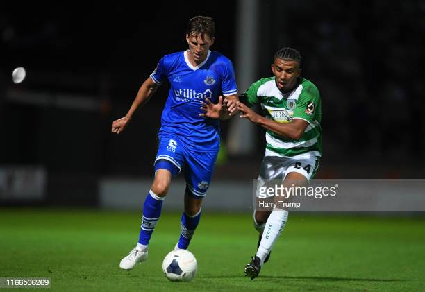 Joe Partington of Eastleigh looks to break past Remeao Hutton of Yeovil Town during the Vanarama National League match between Yeovil Town and...