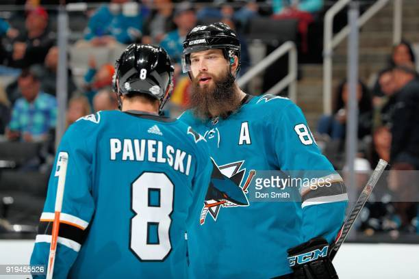 Joe Pavelski and Brent Burns of the San Jose Sharks chat during a NHL game against the Arizona Coyotes at SAP Center on February 13 2018 in San Jose...
