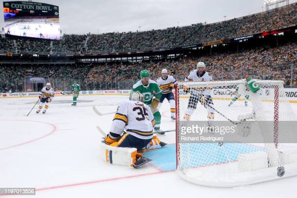 Joe Pavelski and the Dallas Stars get a puck past Pekka Rinne and the Nashville Predators during the Bridgestone NHL Winter Classic at Cotton Bowl on...