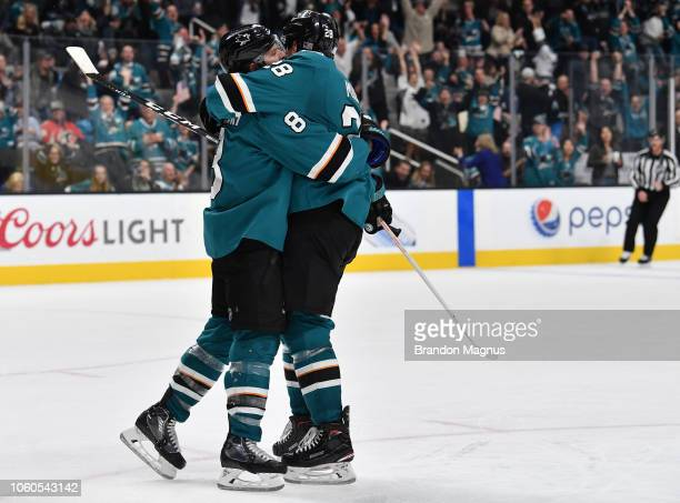 Joe Pavelski and Timo Meier of the San Jose Sharks celebrate a goal against the Calgary Flames at SAP Center on November 11 2018 in San Jose...