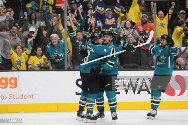 Joe Pavelski and Timo Meier of the San Jose Sharks celebrate a goal against the Vancouver Canucks at SAP Center on February 16 2019 in San Jose...