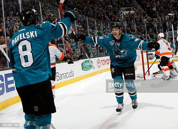 Joe Pavelski and Tomas Hertl of the San Jose Sharks celebrate after Pavelski's game winning goal against the Philadelphia Flyers during a NHL game at...